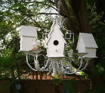 Chandelier Birdhouse & Feeding Station - What a wonderful way to recycle an old chandelier and give it new purpose.