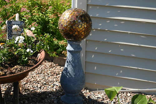 Broken Tile Gazing Ball - An old bowling ball left from the previous homeowner makes a nice piece of garden art.  Bowling ball to broken tile gazing ball.