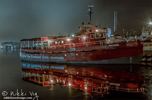Fred A Busse Fire boat at Night - The Fred A. Busse was built in Bay City, Michigan in 1937. A fireboat is a specialized watercraft retrofitted with fire fighting equipment designed for fighting shoreline and watercraft fires. Currently, retired and used for water tours in Sturgeon Bay, WI.