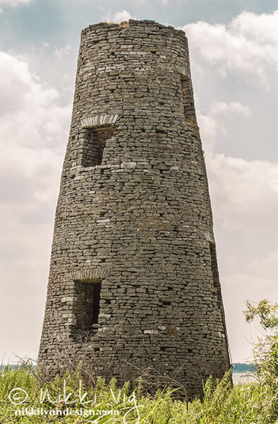The remaining tower from Longtail Point Lighthouse located about 1-1/2 miles North of the mouth of The Fox River. The lighthouse was built in 1847 and the limestone tower is all that remains. Once you reach the island by boat, the tower is accessible by traveling through thick vegetation, including wild raspberry bramble. Photography by Nikki Vig