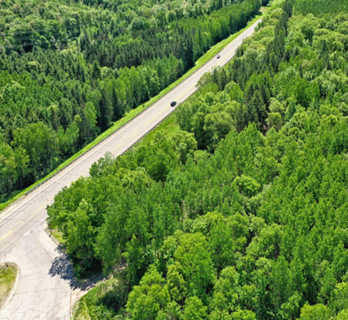 Wisconsin Roadway taken with a drone high above the trees